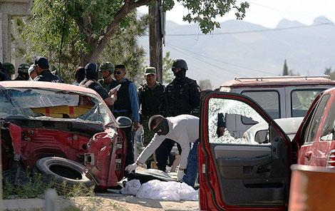 Levantamiento de un cadáver en Ciudad Juárez. | Efe