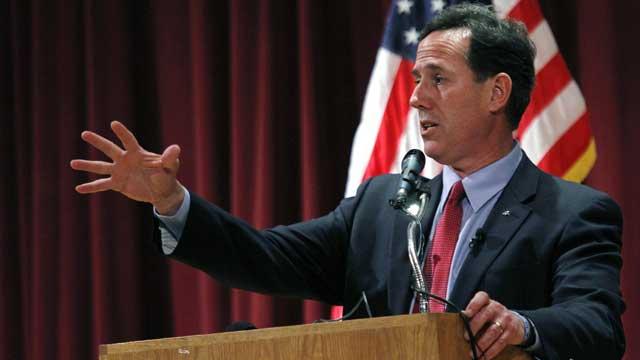 El candidato Rick Santorum, durante un mitin en Phoenix. | Reuters