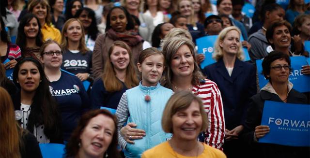 Asistentes a un mitin de Obama en la Universidad de Fairfax, en Virginia. | Reuters