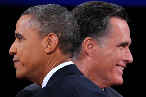Barack Obama y Mitt Romney, en el último debate. | Afp