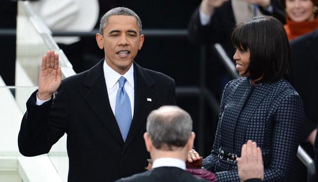El presidente jura su cargo en presencia de Michelle Obama.| Afp
