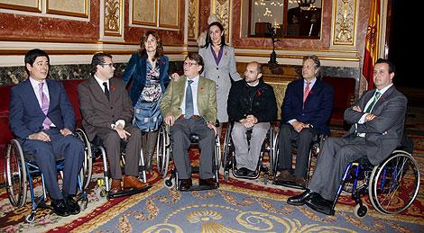 Reunión entre Sáenz de Santamaría y los cargos electos con discapacidad del PP en el Congreso | Efe
