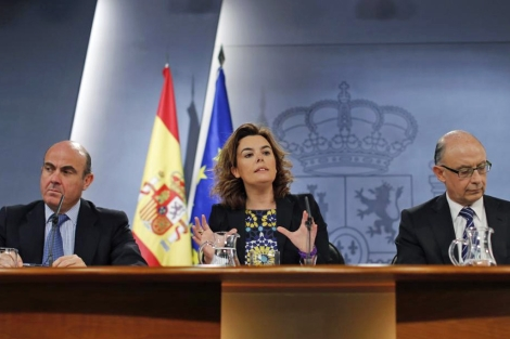De Guindos, Santamara y Montoro tras el Consejo de Ministros. | Reuters