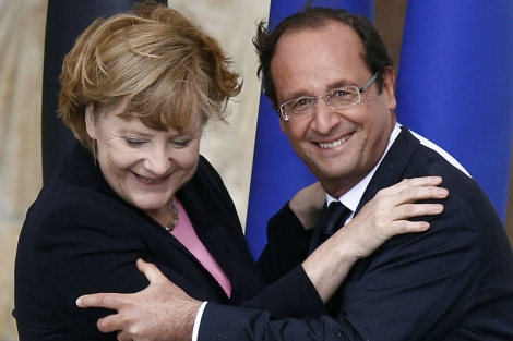 Merkel junto a Hollande. | Reuters