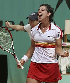 Carla Suárez, tras ganar a Pennetta. (Foto: EFE)
